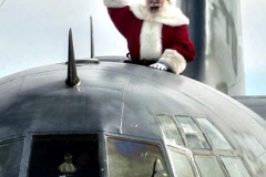 Santa atop Marine C130 delivering 100,000 toys to Hurrican Matthew victims