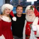 Santa Helper August Johnson and Ryan Seacrest